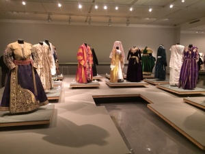 The central platform of the exhibit included dresses for women and robes for men from throughout the world worn in Jewish communities.