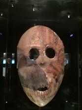 This limestone, asphalt, and pigmented mask was found in the world's oldest cultic hoard along with parts of statues, textiles, beads