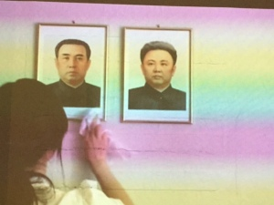 There were a number of video works in the show and this one had the soundtrack for the song.  It is portraits of Kim Jung Il and his son Kim Jung Un of North Korea.