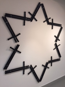 Billy clubs arranged in a Jewish star.  You might call this a work taking off from Duchamp's readymades.
