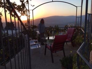 Sunset in Tzfat on the balcony surrounded by grapevines and a great bottle of red wine!
