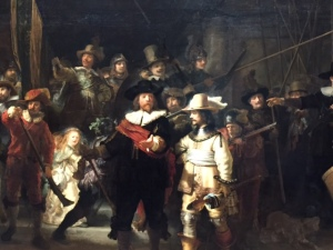 "This painting was called the ""Night Watch"" because it was so dark from years of dirt that some of the figures completely disappeared. One thing I never noticed before is how the foreshortened hand of the Captain that is coming out towards us casts a shadow on the yellow jacket of the figure next to him. Also notice the foreshortened spear. The blue tassle close to the point has very thick paint that really gives the feeling of ropes."