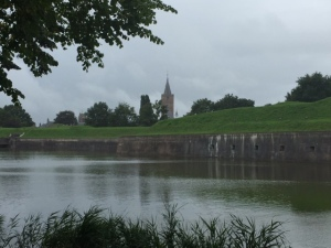 Just before leaving for our trip to Belgium we rode our bikes (a short preparatory ride) around the walls of Naarden a walled city in a star pattern with complete walls and moat from 1300.  The church may even predate that.