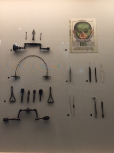 A display of medical instruments from the 15th century, in this case for eye surgery.