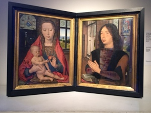 "A devotional work by Memling from 1489 (Diptych of Martin van Nieuwenhove) includes some Renaissance elements that give it some realism. The figures appear to be occupying the same space in the same room and behind Mary is a tiny mirror that shows both their back's as a device similar to Van Eyck's mirror in the ""Arnolfini Portrait"". Having the donor included in a portrait with Mary and Jesus gives him security for the world to come."
