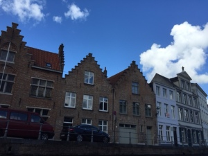 Peaked and crenellated roofs along the canals are a hallmark of the Flemish style of architecture.