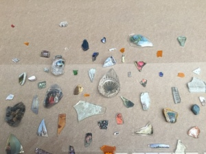 The community was invited in to create from lots of materials made available to them- here shards of glass and pottery.