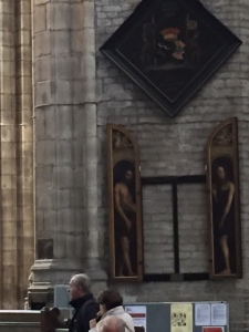 In the 18th century two panels for Adam and Eve were substituted for the nude panels on the altarpiece.  When they were returned to the altarpiece the reproductions were hung elsewhere in the cathedral.