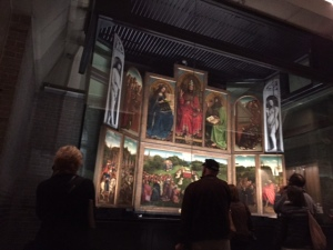 """The """"Adoration of the Mystic Lamb"""" behind bullet proof glass with a limited number of visitors permitted entry.  Restoration work is planned for the next few years to stabilize the condition of the altarpiece."""