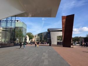 Looking from the entrance of the Stedelijk is a Richard Serra sculpture, the Van Gogh Museum, and the Rijksemuseum in the distance.