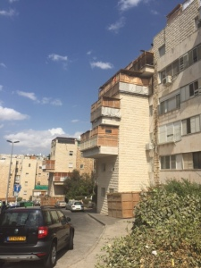 These are some of the sukkot (huts) on the balconies and on the street.  If people don't have a balcony their sukkah is in front and everyone has a designated spot.  Our kids have a prime spot because the man who owns the apartment had a designated spot that they inherited with the apartment.