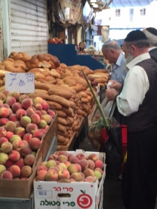 Here you can see the lulav sticking out of the shopping bag. We have seen people carrying them everywhere.