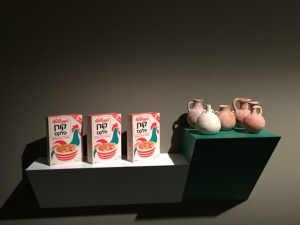 "Haim Steinbach, ""stay with friends 2"", 1986, wooden shelves, Kellogg's boxes, and bronze age pottery"