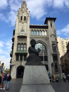 I don't know who the sculpture is supposed to be (reminds me of Cervantes) or what the building is but the combination of the modern and the old gives you and idea of how intermixed the styles are.