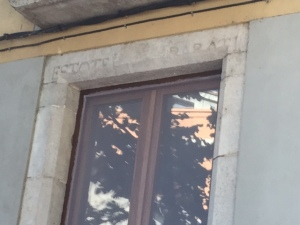 "Since must of the historic center has been reconstructed with materials from various eras notice the lintel of this window ""repurposed"" from the hospital that says in Latin ""Be ready"" since going to the hospital in the 12th century usually meant you went right across the street to the cemetery when you left."