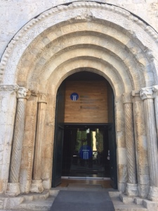 Entrance to the Romanesque church (film museum).  You can see why it is called Romanesque as it uses classical elements of arch and column but is not very embellished.