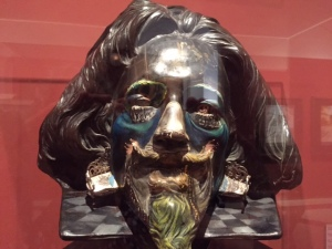 "A bust of the Baroque painter Velasquez in a room with Dali's take off on ""Las Meninas"""