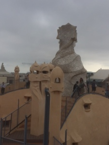 On the roof ventilation and chimneys are no ordinary objects, they became symbolic and animate forms. The entire roof is an undulating mass of forms.