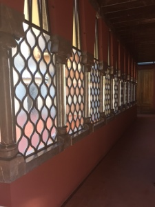Stained glass everywhere even in hallways wherever possible. Notice the glass casings around the columns between the windows. That's the same thing we saw in the Palau Musica Catalunya. Must have been the style of the day.