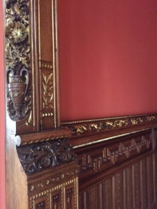 Detail of the wood work and the marquetry (patterns made with small thin veneers of different colors of wood) in the wainscoting.