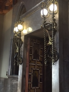 Large sconces either side of the Neo-Gothic style doors