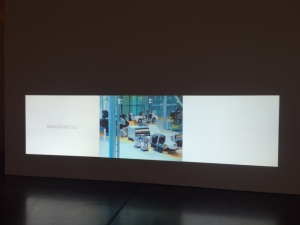 "A video about Volkswagen that talks about their factory being a ""symbol for transparency and authenticity"". The work includes text added by the artist, Octavi Comeron and titled ""Transparent Factory"", 2006.  How ironic given to current issues with Volkswagen."