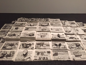 "Francisco Ruiz, ""Cairo Newstand"", 2010, stacks of newspapers featuring propaganda related to the Arab Spring uprising."