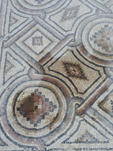 The floors are wetted to show the vivid colors of the mosaics, made from natural stones and pieces of glass.