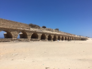 To me the most striking thing is the aqueduct that runs along the shoreline.