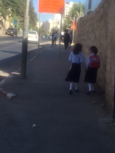 """Girls walking to school by themselves. In the US one hardly ever sees children so young without adult supervision. Isn't it ironic for the place that is supposed to be so """"dangerous"""" that the risk to children is so minimal."""