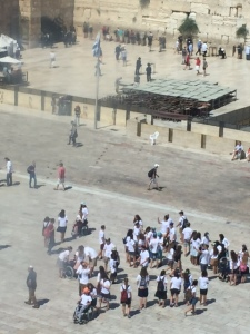 Looking out the window from Aish Ha'Torah (translated as the fire of Torah/the bible) onto a group of disabled students experiencing the Western Wall.