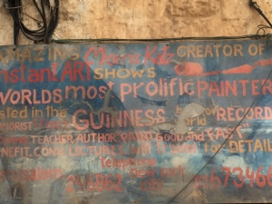 "Down the street from where we are staying in a section of Jerusalem where many artists live (if they can afford it or have lived there for generations) is this sign. I know it is hard to read so in a nut shell: Here lives Morris Katz creator of art shows, the world's most prolific artist listed in the Guinness Book of World Records. Teacher, author of ""Paint Good and Fast"". Would have liked to meet him though his shop was never open."