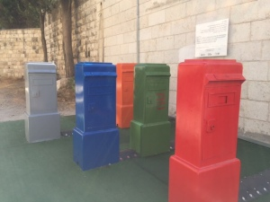 Across from the main post office in Jerusalem is this installation of old mailboxes. Shut and Yuvi Gerstein have set these up so that when you tap on the top of each box they make a specific sound and lights go on across the street on the main post office.