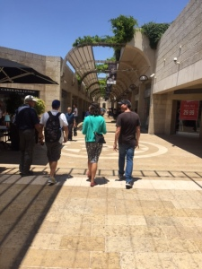 "As we leave the city and return back to the ""modern"" Jerusalem we immediately encounter a shopping mall called Mamila designed by the Israeli architect Moshe Safdie.  It's a stark contrast to where we have just been."