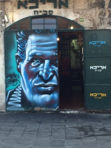 Always thought Paul Newman had beautiful eyes.  This is one of the painted doors in Machane Yehuda (the outdoor market) with stores and stalls all around.  Each outside door is painted by an artist named Solomon Souza.  He's very busy!
