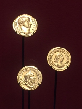 3rd Century CE was a turbulent period with those seeking to seize control striking coins bearing their image and circulating them widely as an attempt to project independence. They often portrayed themselves as soldiers. Since these usurpers didn't last their coins are very rare as not many were made.
