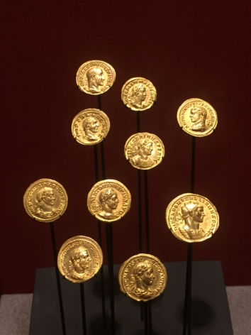 "Coins dating 211-294 CE, the portraits are less delicate and more rugged perhaps to emphasize that these emperors were soldiers as well as rulers and some did not come from ""high society"" either. We even can detect variety ethnicity since most of these emperors were not of Roman or even Italian origin."